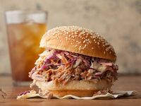 North Carolina Pulled Pork BBQ Sandwich -- Our vinegar-based pulled pork sauce is as tangy as any North Carolinian would expect, plus a little sweet and spicy to boot. #AcrosstheCountry