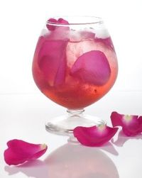 Ever After- Vodka,Raspberry Liqueur, Simple Syrup, Champagne and Garnished with Rose Petals