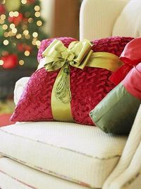 Add a bow to a throw pillow for quick festive decor