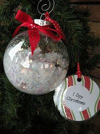 I Spy! ornament. Fill clear ornament with glitter snow and tiny treasures to look for. Include a laminated card with a list of what to find, Glue top on tightly!! -this would be a fun visual game for Natalie. The boys would have fun w/ it too.