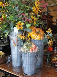 Galvanized planters with gourds
