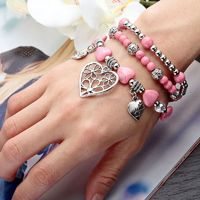 This 3 piece Heart Charm Bracelet Set features pink turquoise, crystal and silver beaded stretchy bracelets dangling silver heart charms. The Pink Turquoise Heart Charm Bracelet Set Silver Beaded is handcrafted of antique silver plating and genuine turquo...