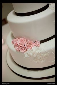Black, white and pale pink wedding cake.