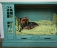 A dog bed made with an old TV set? Way cool.