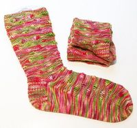 Waving Not Drowning sock by Robyn Gallimore knitted in yarn from Jill Draper.