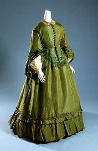 1865 green dress - this is looking very 1870's to me, but according to the Museum at the Fashion Institute of Technology in New York City, it is 1865. LOVE the green. People will tell you that 19th century clothing was all dark and drab. NOT!