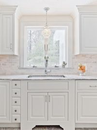 Supreme White granite. it looks like marble but does not have the maintenance issues. Backsplash is Carrara Marble�€