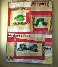 hungry caterpillar quilt. http://sarahhodgsonblog.blogspot.co.uk/2012/02/very-hungry-caterpillar-pennys-quilt.html