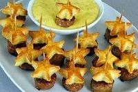 Spicy Sausage Star Skewers: Cut stars from Pillsbury Flaky Biscuit dough with cookie cutters and bake. Attach to sausage circles with toothpicks and serve with Grey Poupon Mustard. Transportable and Tasty!