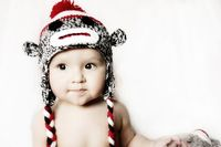 Crochet baby sock monkey hat