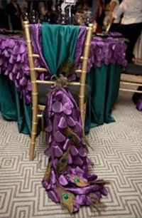 For those of you with a larger wedding budget, try using textured and scaled tablecloths with absolutely unique chair ties that drape the floor and end with a peacock feather. Take a look at this stunning wedding reception place setting�€�your weddi...
