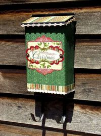 Scrapbook paper on mailbox.