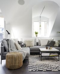sloped ceiling living room in shades of grey