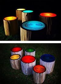 Create outdoor stools from tree trunks then paint them with glow paint - instant party lights! Looks like ferngully! =).....i want to do this but on posts around the garden or in landscape around the house !