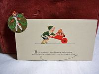 Adorable 1920's Christmas card child pushing wheel barrel full of toys unused. $6.00, via Etsy.
