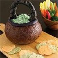 Spinach dip? Always welcome at a #party. But if you're having a #Halloween bash, try this bread bowl #cauldron. #recipe