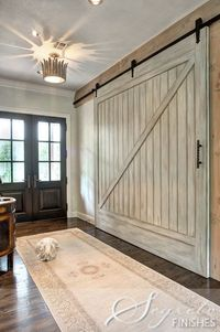 Barn Doorswould be a good look to hide utility room.