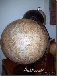 Regular globe, coated with tissue paper, Modge Podge and walnut ink.