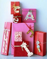 """Gift Monogram: Recycle holiday cards as labels for presents. With a pencil, kids can draw (or stencil) the recipient's initial onto a card and cut it out. Punch a hole in the letter, and tie to gift with yarn or ribbon."""