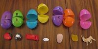use plastic eggs with letters and items for each letter.