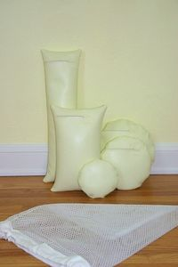 Five Pale Butter Yellow Waterproof Vinyl Photo Props for Positioning Baby, Bundled in a Sack. $95.00, via Etsy.