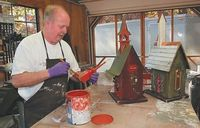 Larry Burger paints a steeple for one of his custom birdhouses; he will be selling them at this year's Foothills Craft Guild's 42nd annual Fine Craft Fair.