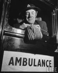 knitordie: Ambulance driver knitting for the English army during WWII.