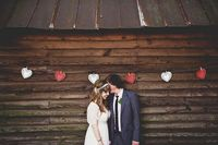 Love the simple doily garland on the side of this weathered barn, such a darling photo backdrop