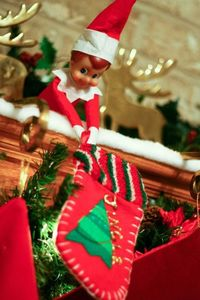 Elf brings his own stocking to hang up with the rest of the family. Idea from my friend Jodi! LOVE IT!