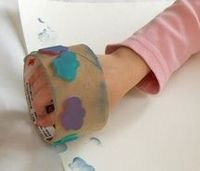 Use and empty cardboard tape roll, attach foam stickers and you have a unique kid made stamp wheel
