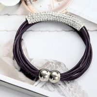 This multi strand bead bracelet features a leather multi-strand design accented by a curved tube bar paved with rhinestones.The magnetic clasp makes this tube leather bracelet simple and easy to fasten.