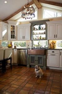 Windows instead of backsplash... lets in light without taking up cabinet space! Wow, cool idea!
