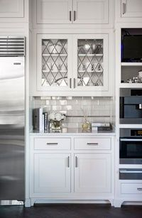 gorgeous glass on the upper cabinets