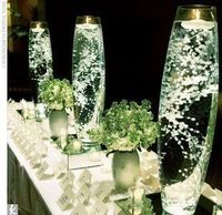 Baby's Breath submerged in water & topped with floating candle :)